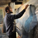 Caleb Stoltzfus in studio painting The Flood